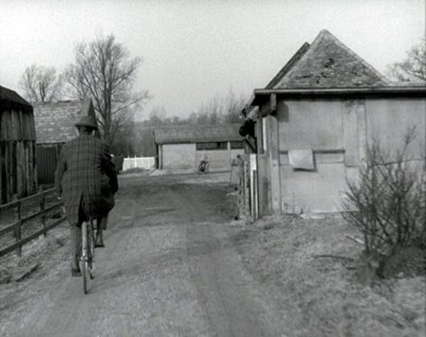"Still from the TV series ""The Avengers"" taken as one of the protaganists cycles towards Thrift Farm Lane from Thrift Farm"