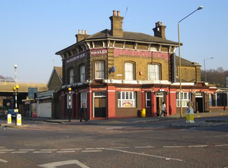 The Harrow Inn public house is mentioned in a description of the hamlet of Abbey Wood in the late 1860s when it was one of the very few buildings. It is at the junction of Abbey Wood Road with Wilton Road. The A2041 Harrow Manorway flyover across the railway can be seen in the distance on the left. Various on-line pub guides describe the clientele of the pub as local. Demolished in 2009 and now a derelict site. Photographer: Nigel Cox.
